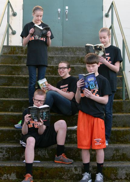 by: SUBMITTED BY KRISTIE FREEMAN - Middle School students, from left: Nate Maller, Kaitlyn Bakkensen, Linnaea Kavulich, Jimmy Jones and Alyssa Bakkensen form just one of the four teams the Scappoose School District sent to the Oregon Battle of the Books regional competition in Portland March 16.