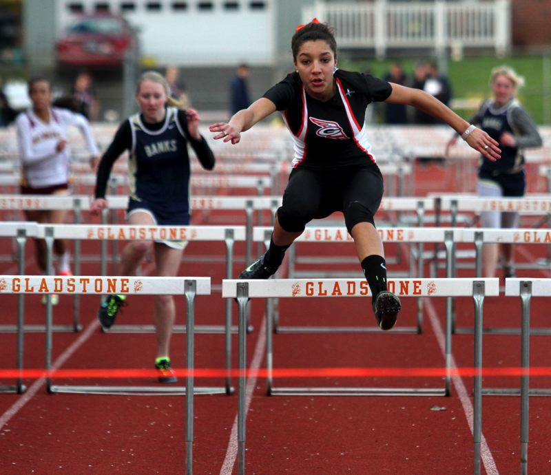 by: JON HOUSE - Gladstone freshman Tieara Norman sets the pace in the high hurdles at last weeks meet with Milwaukie and Banks. Norman is fast proving herself one of the top Class 4A hurdlers and jumpers in the state. Through competition last week, she had the states second best marks for Class 4A in both the high hurdles and the long jump.