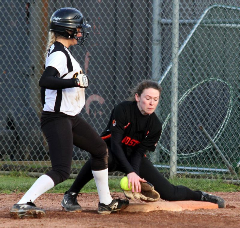 by: JON HOUSE -      Gladstone second baseman Julia Schumaker holds a Cascade player on first base in last weeks 2-0 win over the Cougars. Cascade lost to Banks in the state final last year.