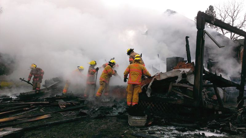 by: COURTESY OF MOLALLA FIRE DISTRICT: JENNA HIRD  - Molalla firefighters checked for hot spots this weekend at a fire that destroyed a Dickey Prairie Road house Saturday. One firefighter was slightly injured in the blaze.