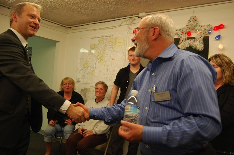 by: FILE PHOTO: RAYMOND RENDLEMAN - Commissioner Paul Savas and John Lee, chairman of Clackamas County's Republican Party, shake hands on election night in May 2011 to support funding for local infrastructure as an alternative to the Sellwood Bridge fee.