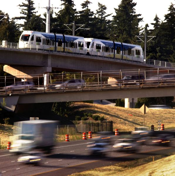 by: PAMPLIN MEDIA GROUP FILE PHOTO: L.E. BASKOW - TriMet's Green Line MAX trains cross Johnson Creek Boulevard while carrying passengers between Gateway and Clackamas Town Center as a way to reduce traffic congestion on Interstate 205.