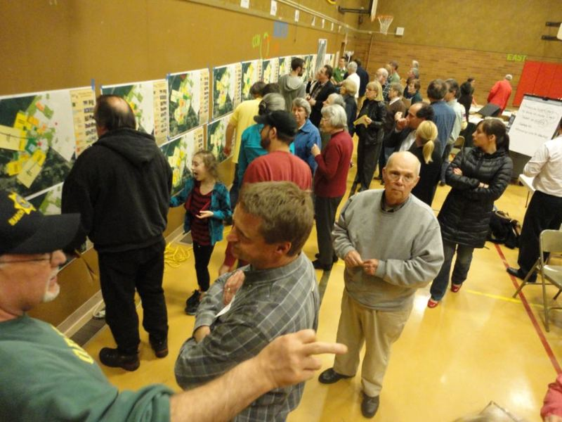 by: PHOTO COURTESY: CITY OF OREGON CITY - Hundreds of community members play the planning game at a February South End neighborhood meeting at McLoughlin Elementary.