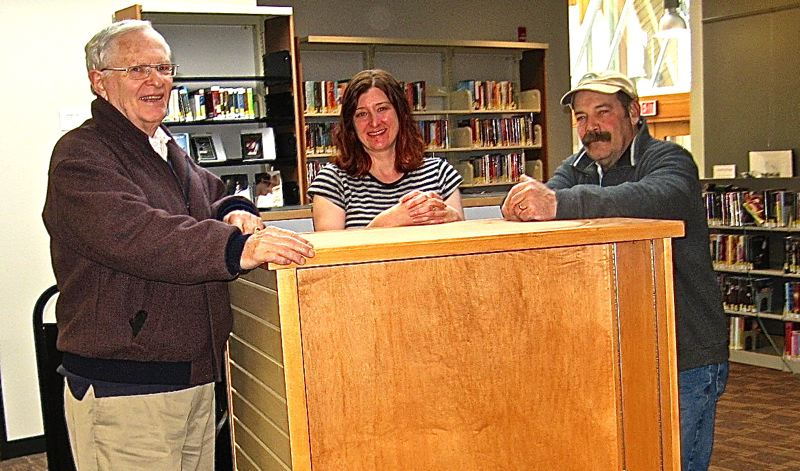 by:  CONTRIBUTED PHOTO - Pictured, from left, are Friends President George Hoyt, Childrens Librarian Monica Smith and cabinetmaker Dennis Duhrkoop.