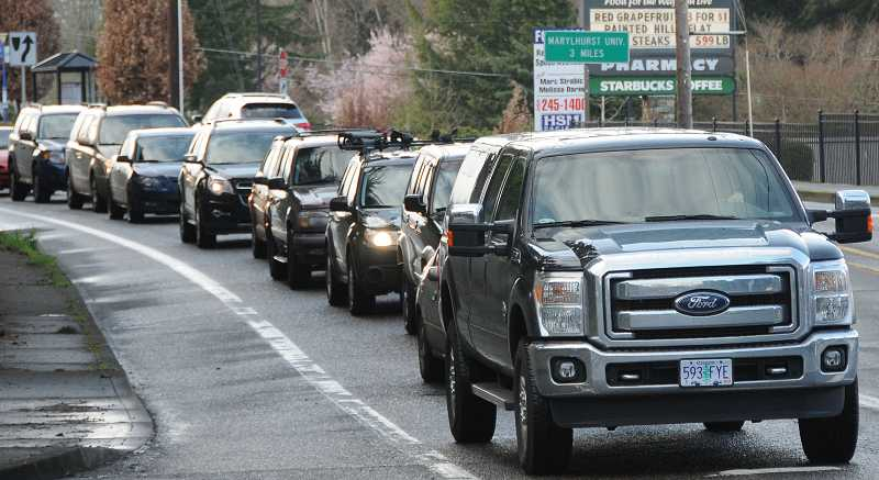 by: FILE PHOTO - Rush-hour gridlock at Highway 217 and Interstate 5 in Tigard is one of the things Metro hopes to ease with its goal of reducing vehicle use. The agency is tasked with reducing greenhouse gas emissions from cars by 2035.