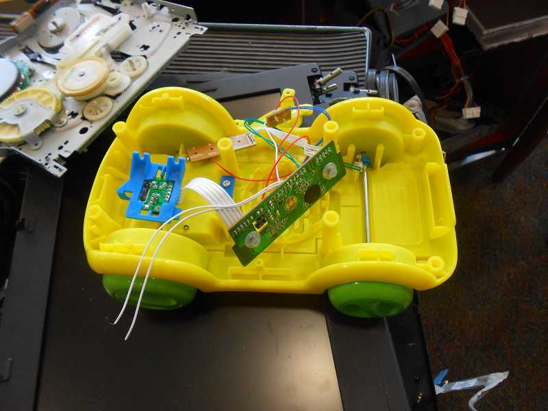 by: TIDINGS PHOTO: PATRICK MALEE - Here's the inside of an electric toy car that Michael Diltz and the students hope to make run again.