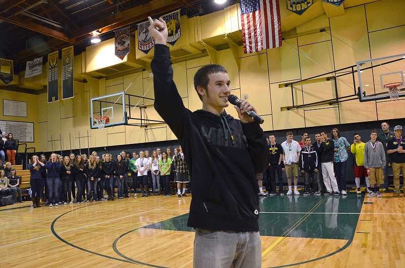 by: TIDINGS PHOTO: VERN UYETAKE -  Mitch Mondor leads a cheer at the assembly to honor West Linn High School's state championship competitors.