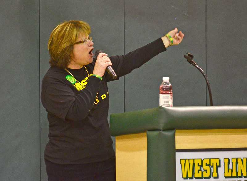 by: TIDINGS PHOTO: VERN UYETAKE - Angie Hammond introduces the WLHS champions in various sports.