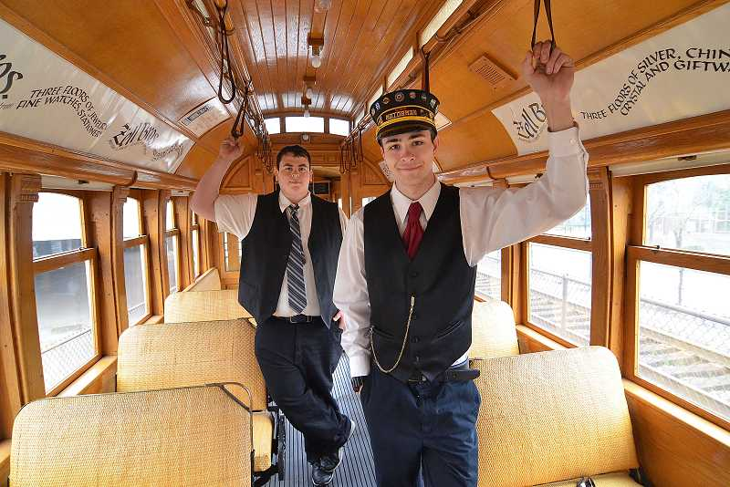 by: VERN UYETAKE - Gage Geist, of Milwaukie, on the right, and Itamar Reuven, who lives in California but used to live in Lake Oswego, stand in a vintage trolley that arrived in Lake Oswego on Tuesday. The two 18-year-olds are among about 20 volunteers who help operate the Willamette Shore Trolley.