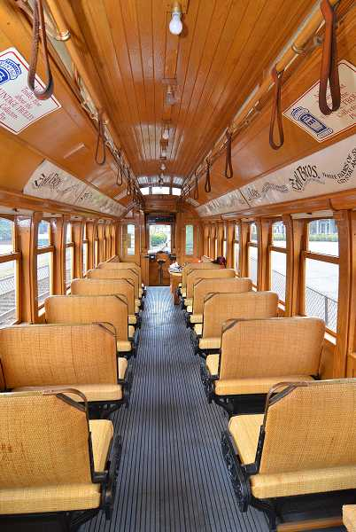 by: VERN UYETAKE - The newly leased trolley car, a replica of Portland's Council Crest cars from a century ago, seats 40 people in wicker seats with walkover-style backrests.