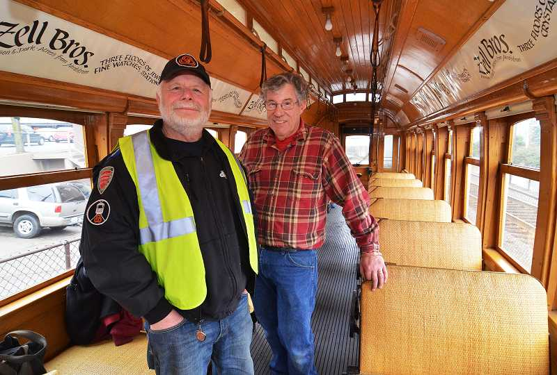 by: VERN UYETAKE - Hal Rosene, superintendent of operations, and Dave Rowe, better known to some as 'Trolley Dave,' stand in the newest Willamette Shore Trolley car, which could be running between Lake Oswego and Portland as soon as June.