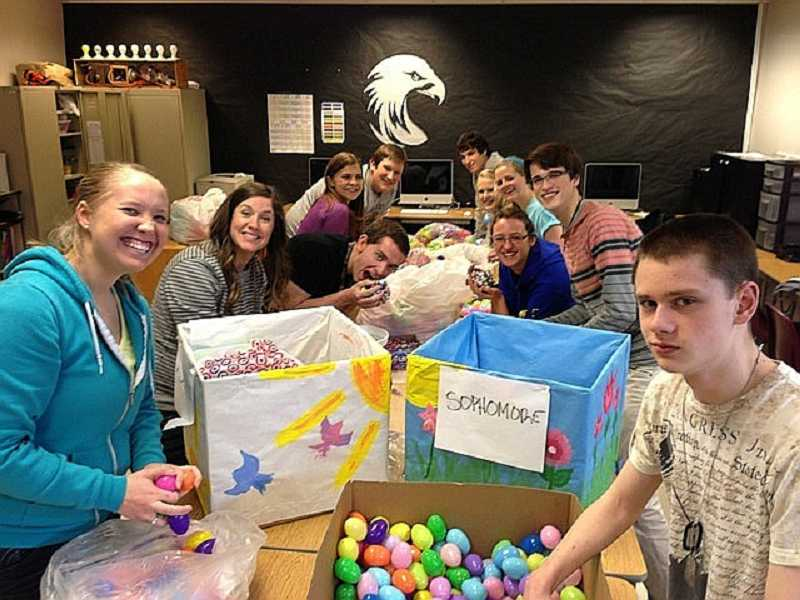 by: SUBMITTED PHOTO - Westside Christian High School students prepared more than 11,000 candy-filled eggs and donated them to an Easter egg hunt for low-income families.