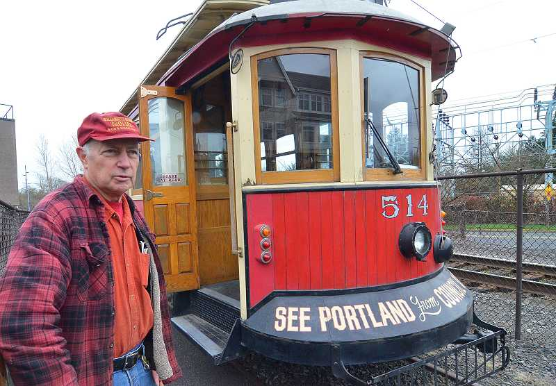 by: VERN UYETAKE - Rod Cox, the Willamette Shore Trolley's general manager, stands next to the line's new trolley car by the old railroad depot at 311 N. State St. in Lake Oswego. He hopes to have the line back up and running this summer.