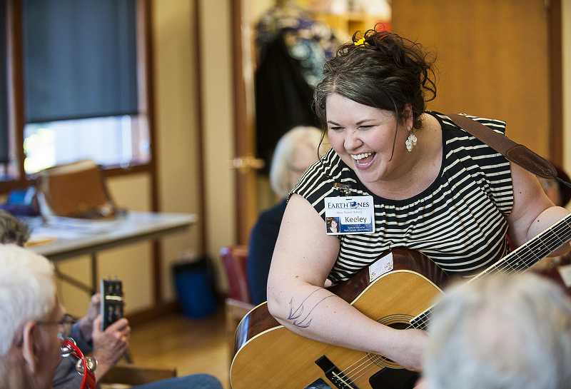 by: JOSH KULLA - Kelley St. Claire of Earthtones Music Therapy Services gets everybody singing, clapping and foot tapping during a recent music therapy session at the Lake Oswego Adult Community Center.