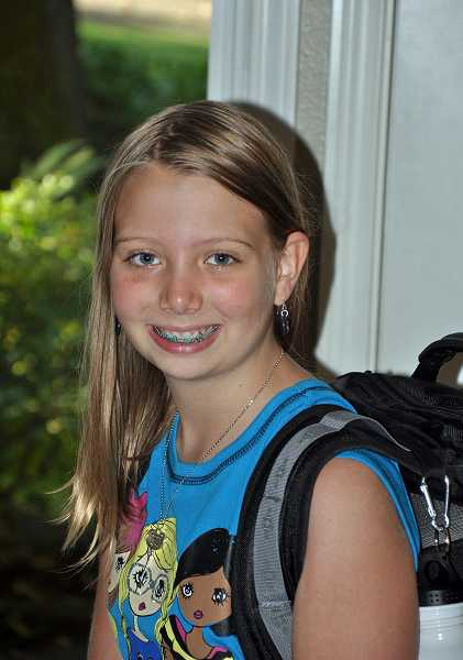 by: SUBMITTED PHOTO - Peyton Holstein, 11, put together a campaign to give 45 backpacks to Clackamas County foster children.