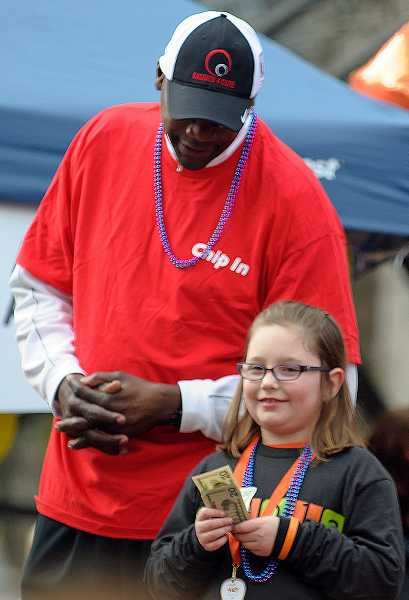 by: SUBMITTED PHOTO - A former player for the Portland Trail Blazers, Jerome Kerseys $100 donation helped Claire Sarnowksi reach her fundraising goal of $3,000 last year during the Walk MS event in Portland.