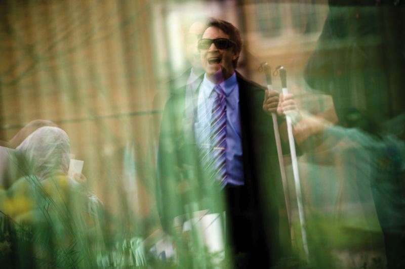 by: TRIBUNE PHOTO: CHRISTOPHER ONSTOTT - Art Stevenson leads a demonstration outside the Oregon Commission for the Blind headquarters to protest the hiring of a sighted executive director over a qualified blind candidate.