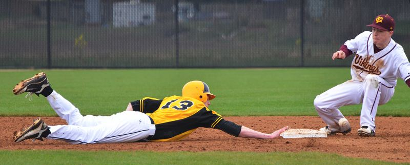 by: JOHN BREWINGTON - Back to second. St. Helens' Brennan Norton dives back to second base and the ball gets by Forest Grove fielder during Tuesday's game. Forest Grove hosted the tournament.