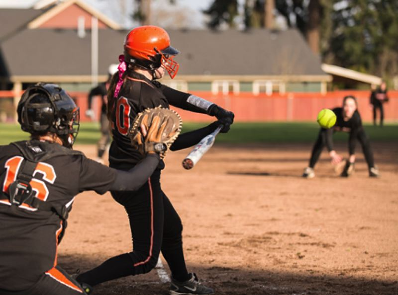 by: JEREMY DUECK - Scappoose's Amanda Schlosser takes a cut at the ball during last week's game with Molalla. The Lady Indians kept the game close, but three late runs gave the visiting Indians the win.