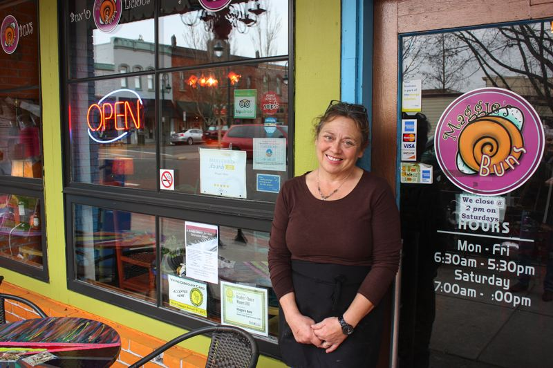 by: NEWS-TIMES PHOTO: DOUG BURKHARDT - Maggie Pike appreciates the community support during her professional crisis. Despite the anguish caused by a mysterious norovirus outbreak, Pike considers herself so lucky because of her loyal friends and customers.