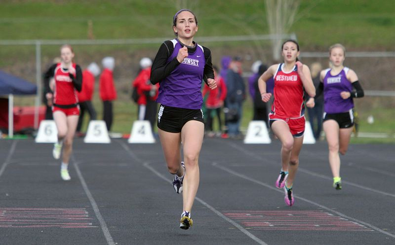 by: MILES VANCE - FOR THE WIN - Sunset's Kendall Butz races to victory in the 400 meters during her team's win over Westview at Westview High School on March 20.
