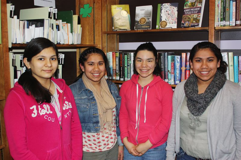 by: HILLSBORO TRIBUNE PHOTO: DOUG BURKHARDT - The Cornelius Public Library's Teen Advisory Group has a plan to accept food donations in exchange for a reduction in library fines, and several group members (left to right) Vanessa Gomez Torres, Alondra Rojo, Adrianna Calderon and Alejandra Rojo came to the library last week to promote the program. 'Food for Fines'will be in effect April 19-21.