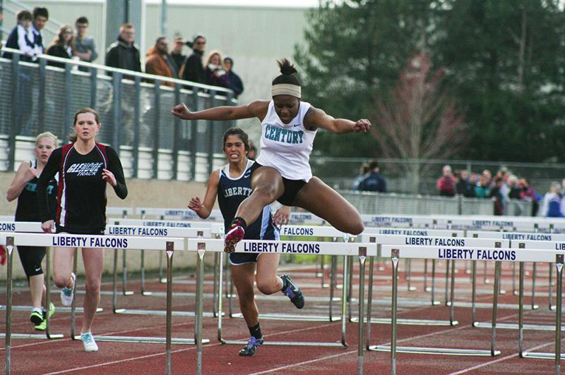 by: HILLSBORO TRIBUNE PHOTO: AMANDA MILES - Century's Jikuesiah Jones races to victory in the girls 100-meter hurdles with a time of 17.09 seconds.