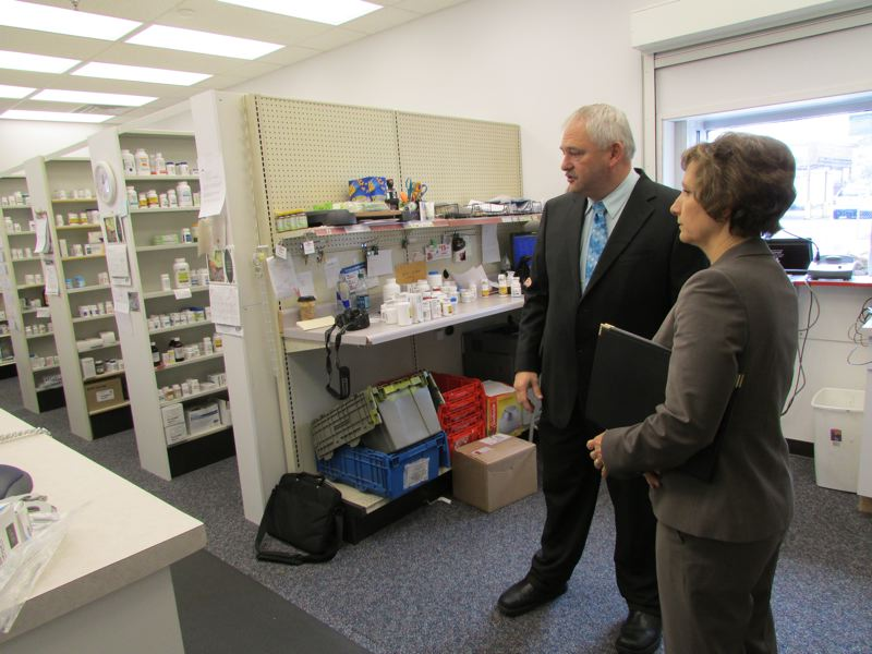 by: SPOTLIGHT PHOTO: ROBIN JOHNSON - Congresswoman Suzanne Bonamici discusses health care issues, such as the inflated pricing of some prescription drugs, while touring a Scappoose pharmacy.