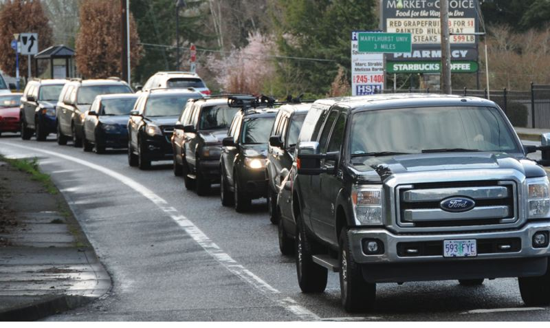 by: PHOTO BY: VERN UYETAKE - Anyone who commutes along Highway 43 in West Linn knows how congested the road gets. Metro is campaigning to reduce the number of vehicles on the road.