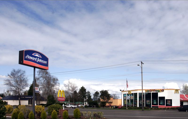 by: OUTLOOK PHOTO: JIM CLARK - Heroin dealers were staying at the Howard Johnson Hotel on Northeast Burnside Road in Gresham. A man who overdosed in the McDonalds restroom across the street helped lead police to them. In fact, one of the alleged dealers fled to the fast food restaurant before police caught him.