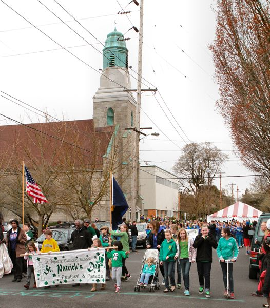 by: DAVID F. ASHTON - Out steps Sellwood's 15th Annual St. Patrick's Day Parade -  heading out from St. Agatha's Catholic Church and School.