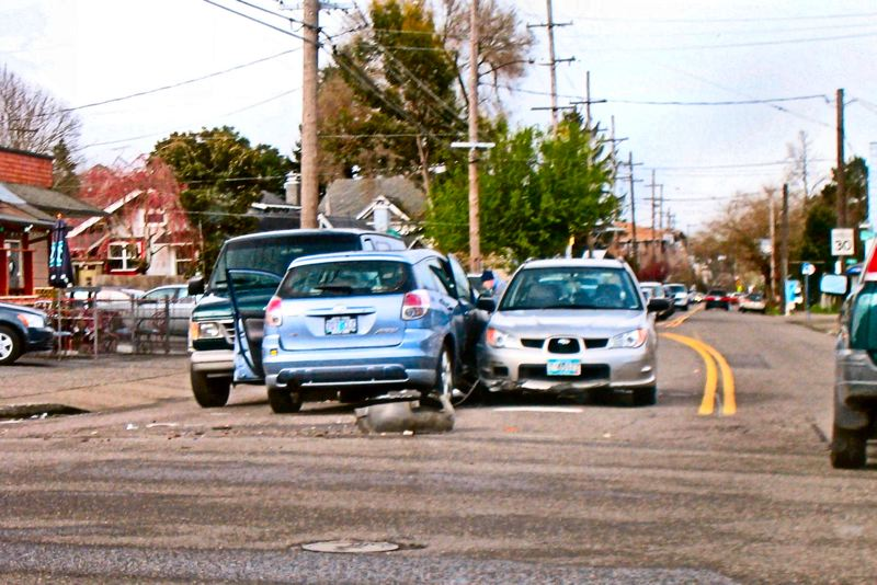 by: ERIC NORBERG - This peculiar-looking crash on Milwaukie Avenue at Holgate occurred in broad daylight - at 4:30 pm on March 23.