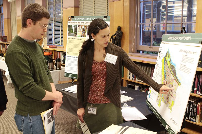 by: DAVID F. ASHTON - Russ Grandgeorge, a Woodstock resident, learns about 'Urban Design Framework' from Portland Bureau of Planning and Sustainability City Planner Lora Lillard.