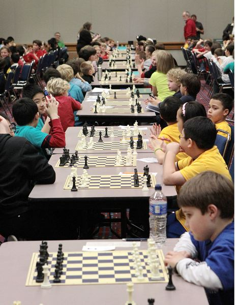 by: DAVID F. ASHTON - With boards set on long rows of tables, local chess club members take on top players representing schools from 19 school districts in eight counties, in two states and in two time zones 2013 Chess for Success State Chess Tournament.