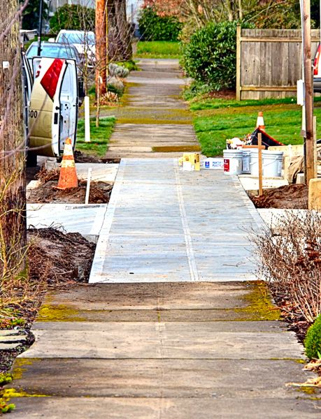 by: PHOTO COURTESY OF CALVIN NOLING - The reader is disconcerted by new builder-installed sidewalks that do not line up with established sidewalks, for whatever reason.