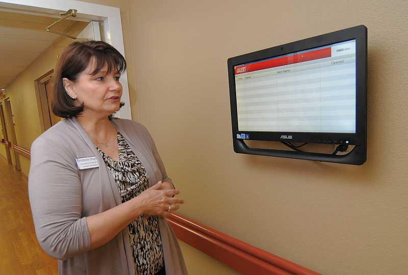 by: REVIEW PHOTOS: VERN UYETAKE - Victoria Doyle, admissions coordinator at Rose Linn Care Center, points out a part of the state-of-the-art system that was included in the renovation.