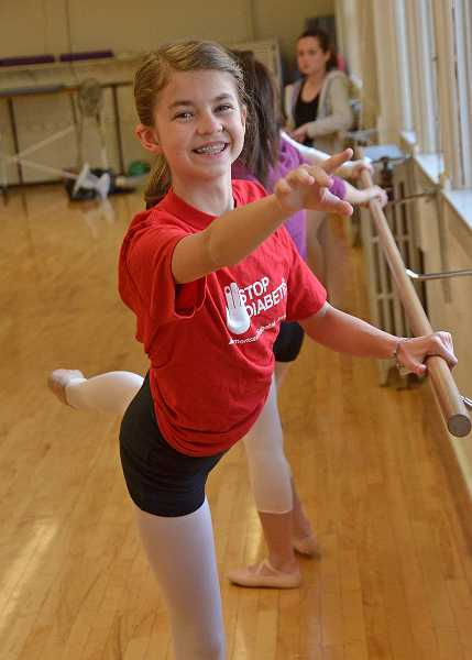 by: TIDINGS PHOTO: VERN UYETAKE - Katie Bruun practices ballet while wearing a Stop Diabetes shirt.