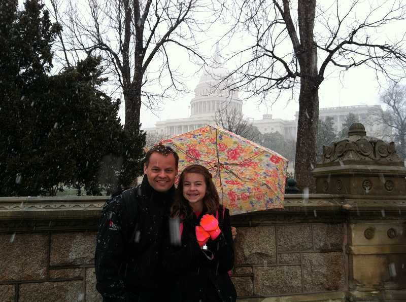 by: SUBMITTED PHOTO - Scott and Katie Bruun stand outside the United States Capitol building during their trip on behalf of the 'Call to Congress' event in early March.
