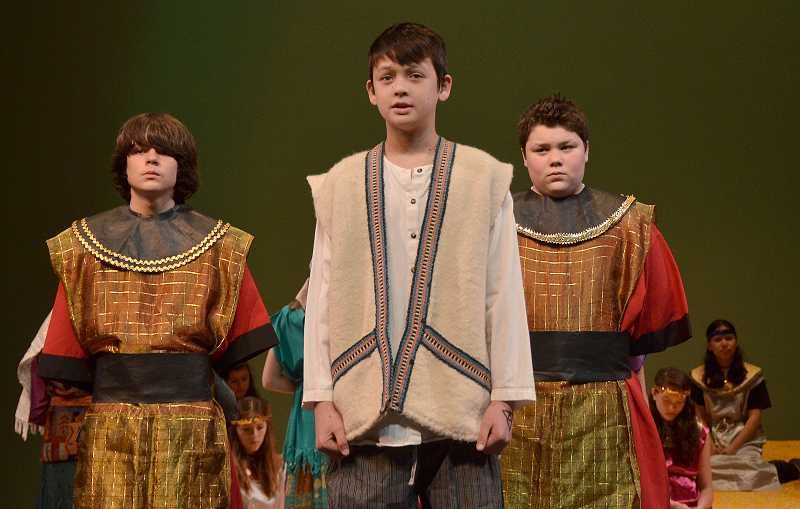 by: TIDINGS PHOTO: VERN UYETAKE - Logan Williamson, Nathaniel Colman and Sam Raffetto, all from Athey Creek, practice their roles.