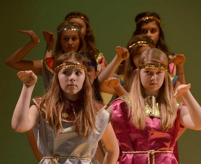 by: TIDINGS PHOTO: VERN UYETAKE - Morgan Mankin, Laura Notario and Sophie Shelbourne practice their roles as Pharoah Groupies.