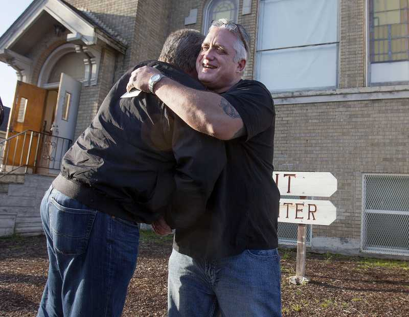 by: TIMES PHOTO: JONATHAN HOUSE - Iron Tribe cofounder and leader Harold Bear Cubbedge hugs an associate before a recovery meeting. Bear emphasizes spirituality and family in helping former addicts and prisoners transition back to normal life.
