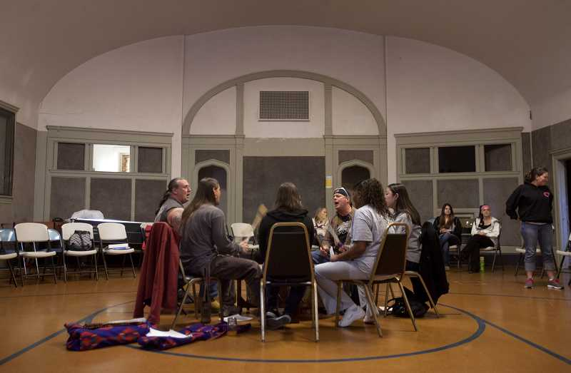 by: TIMES PHOTO: JONATHAN HOUSE - Iron Tribe members fomr a drum circle prior to the beginning of their recovery meeting, as a way to bring energy for the night.