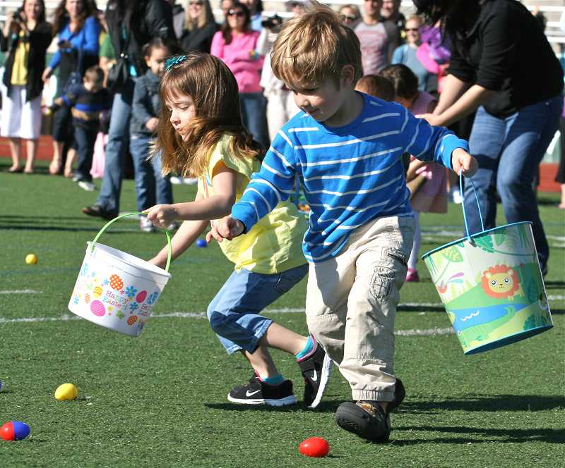 by: J. BRIAN MONIHAN - Its easy picking as kids of all ages race to scoop up as many eggs as they can.