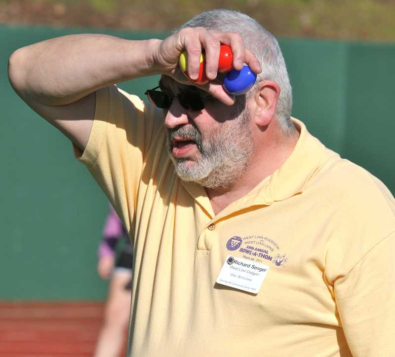 by: J. BRIAN MONIHAN - West Linn Lions Club President Richard Senger is on the lookout with some additional eggs for any child who might not have found any.