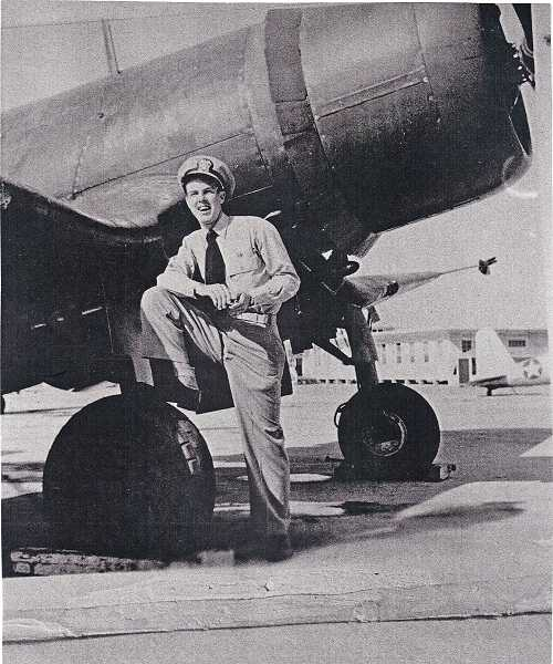 by: SUBMITTED PHOTO - Ensign Joe Adams, a naval fighter pilot, stands by his plane in the fall of 1945 at the El Centro, Calif., naval air station.