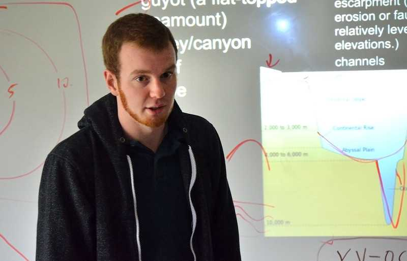 by: REVIEW PHOTO: VERN UYETAKE - Riverdale High School student Logan Rooper is teaching his own advanced science class.