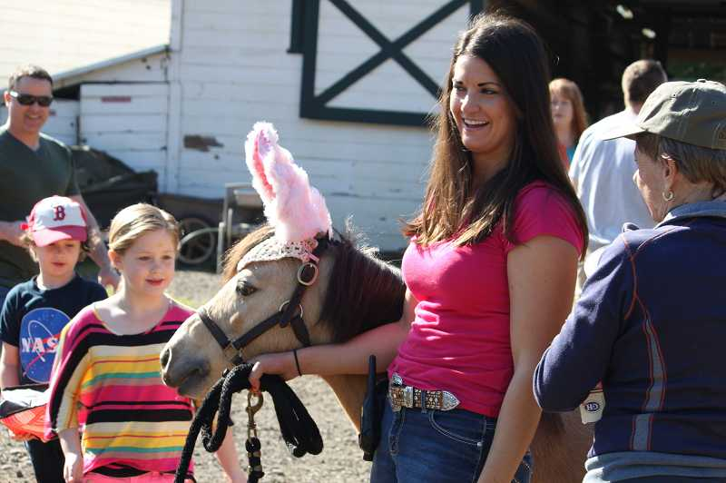 by: SEAN MINOGUE - Katie Purdy shows off Otis the pony with his bunny ears to several area youngsters at the Hunt.