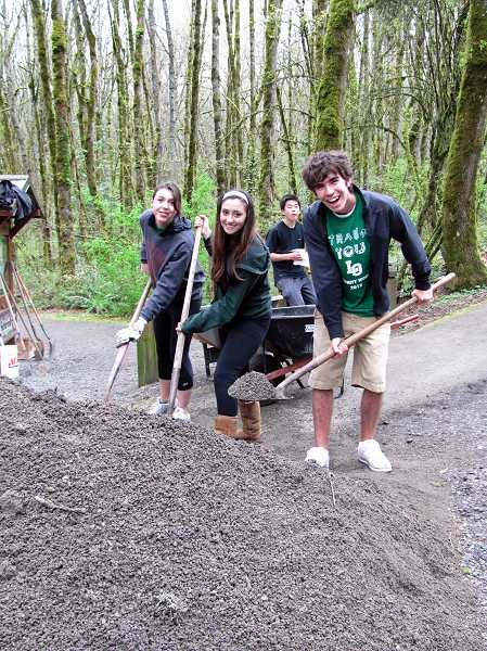 by: SUBMITTED FILE PHOTO: PAUL LYONS - Lake Oswego High School volunteers, from left, Christy Wood, Olivia Anderson, Kevin Le and Josh Nudelman in April 2012 helped spread gravel at Springbrook Park. All students shown here but Le, who is a senior, graduated last year.