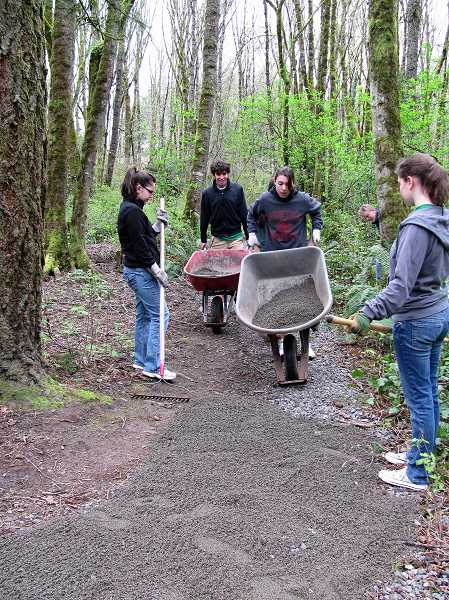 by: SUBMITTED PHOTO: PAUL LYONS - Lake Oswego High School students, from left, Josh Nudelman, Christy Wood and Lauren Zurcher kept things rolling at Springbrook Park last year.