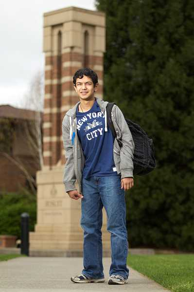 by: TIMES PHOTO: JAIME VALDEZ - Varun Sah, a junior at Jesuit High School, enjoys a break by the quad tower near the school's entrance off Beaverton-Hillsdale Highway.